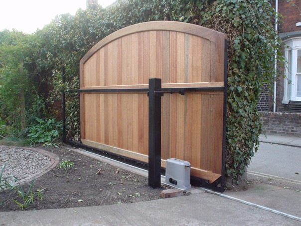 Sliding gates 1 tps gates doors ltd electric gates for Wooden sliding driveway gates