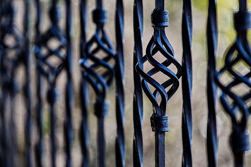 Close up of black metal gate