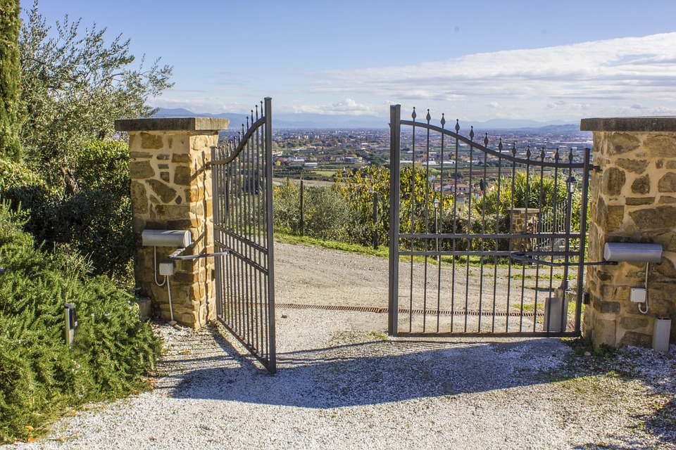 Open steel gates with scenic view