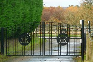 electric steel gates in wooded area